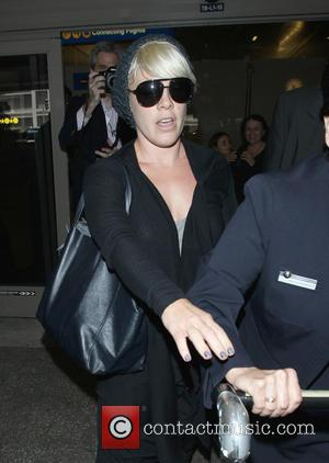 Pink and Alicia Moore - Pink (real name Alicia Moore) arrives at Los Angeles International Airport (LAX) wearing dark aviator...
