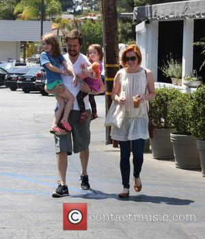 alison hanningan - Alyson Hannigan holds her iced coffee while husband Alexis Denisof  holds the kids on a family...