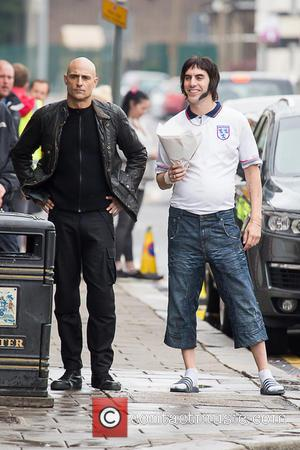 Sacha Baron Cohen and Mark Strong - Sacha Baron Cohen and Mark Strong spotted filming 'Grimsby' in Essex - Purfleet,...