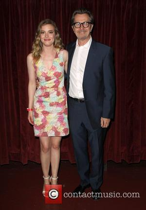 Gillian Jacobs and Gary Oldman