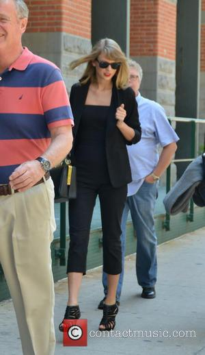 Taylor Swift, Scott Swift and Andrea Finley - Taylor Swift spotted out in New York wearing all black carrying the...