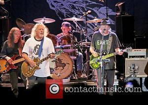 Rick Rosas, Frank \poncho\ Sampedro, Neil Young and Ralph Molina