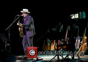 Elvis Costello - Elvis Costello performing at Bridgewater Hall in Manchester - Manchester, United Kingdom - Monday 14th July 2014