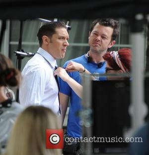 Tom Hardy - Tom Hardy and Emily Browning on set of the film 'Legend' in East London - London, United...