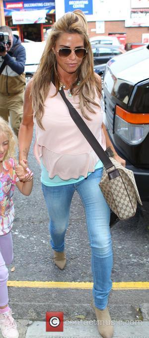 Katie Price and Jordan - Katie Price arrives at Fubar Radio studios with her daughter Princess - London, United Kingdom...