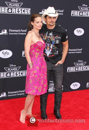 Brad Paisley and Kimberly Williams-Paisley - Disney's \Planes: Fire & Rescue\ - Los Angeles Premiere - Hollywood, California, United States...