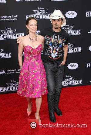Brad Paisley and Kimberly Williams-Paisley - Disney's Planes: Fire & Rescue Los Angeles Premiere held at El Capitan Theatre -...