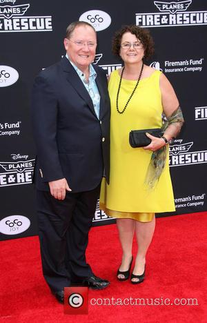 Executive producer John Lasseter and his wife Nancy Lasseter - Disney's Planes: Fire & Rescue Los Angeles Premiere held at...