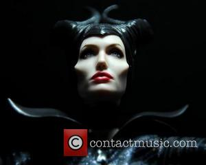 Angelina Jolie and Maleficent - Accomplishing this feat requires many photos of the famous person/character, plenty of time, and a...