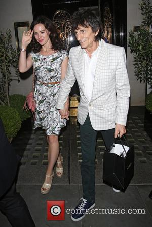 Ronnie wood and Sally Humphreys - Ronnie Wood Leaving Scotts restaurant in Mayfair - London, United Kingdom - Thursday 17th...