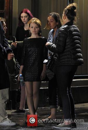 Emily Browning - Tom Hardy and Emily Browning film scenes from their latest movie 'Legend' outside The Ivy House in...
