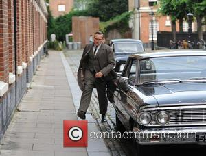 Christopher Eccleston - Tom Hardy on the set of 'Legend' in East London - London, United Kingdom - Friday 18th...