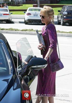 Melanie Griffith - Melanie Griffith wearing a long purple patterned dress and smoking a cigarette at Pacific Design Center. Griffith...