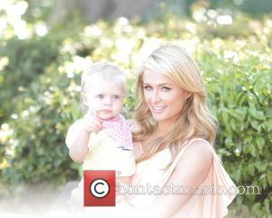 Paris Hilton - Paris Hilton appears for interview on Extra TV Show, with Mario Lopez, at Universal City Walk. -...