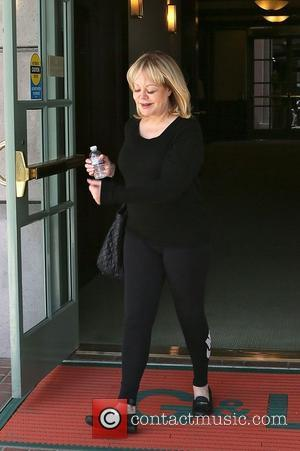 Candy Spelling - Candy Spelling exits a medical center in Beverly Hills wearing an all black outfit, including Nike leggings...