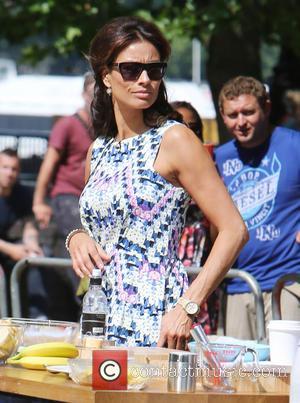 Melanie Sykes and Gino D'Acampo - Melanie Sykes and Gino D'Acampo film 'Let's Do Lunch with Gino & Mel' on...