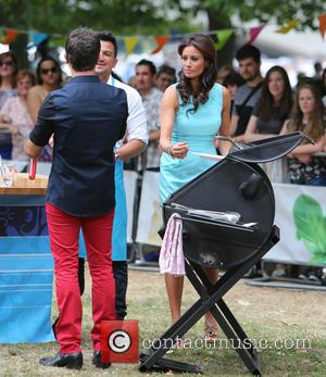 Gino D'Acampo and Melanie Sykes - Celebrities filming 'Let's do lunch with Gino and Mel' on the Southbank - London,...