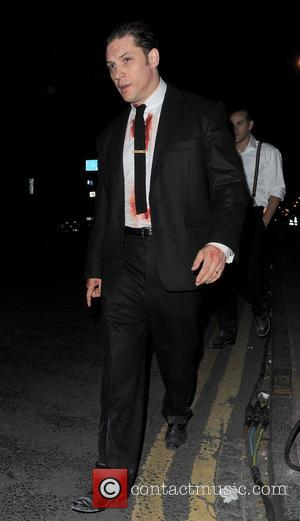 Tom Hardy - Tom Hardy covered in blood leaves the movie location at East London Canal after filming a winter...