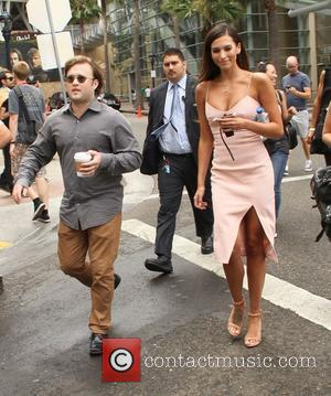 Haley Joel Osment and Genesis Rodriguez - San Diego Comic-Con International - Day 2 - Celebrity Sightings - San Diego,...