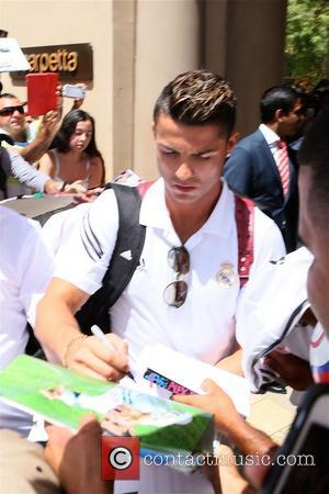 Cristiano Ronaldo - Cristiano Ronaldo mobbed by fans as he leaves The Montage Hotel in Beverly Hills - Los Angeles,...