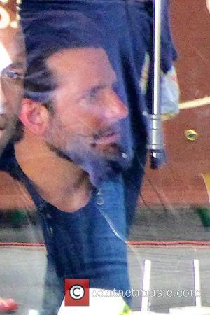 Bradley Cooper Works A Shift At Burger King
