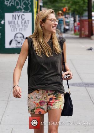 Jessica Hart - Jessica Hart and Ashley Hart walking around the East Village - New York City, New York, United...