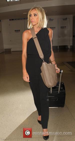 Giuliana Rancic - Giuliana Rancic arrives at Los Angeles International Airport (LAX) - Los Angeles, California, United States - Monday...