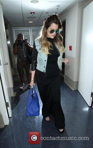 Khloe Kardashian - Khloe Kardashian at Los Angeles International Airport (LAX) with extremely wavy hair - Los Angeles, California, United...