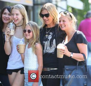 Kate Moss, Lila Grace and Anais Gallagher - Kate Moss, wearing an Amy Winehouse T-shirt, out in Primrose Hill with...
