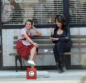 Lea Michele and Katey Sagal - Lea Michele is seen wearing a waitress outfit and smoking cigarettes with co-star Katey...