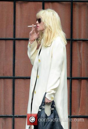 Courtney Love - Courtney Love smokes a cigarette as she leaves her hotel in New York. - New York City,...