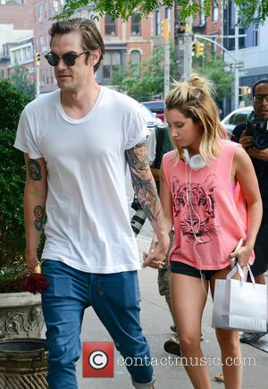 Ashley Tisdale and Christopher French - Ashley Tisdale and her fiance Christopher French hold hands as they go shopping at...