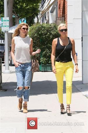 Brandi Glanville and Yolanda Forster - Brandi Glanville and Yolanda Foster stop at Theodore while out shopping in Beverly Hills...