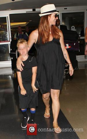 Poppy Montgomery and Jackson Kaufman - Poppy Montgomery arrives at Los Angeles International (LAX) airport with her family - Los...