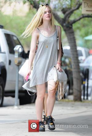 Elle Fanning - Elle Fanning spotted out in Los Angeles wearing Nike sneakers and a simple grey dress - Los...
