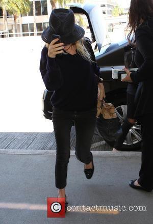 Ashley Olsen - Ashley Olsen keeps her head down as she arrives at Los Angeles International (LAX) airport - Los...