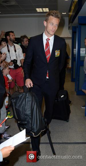 Anders Lindegaard - Manchester United Players arrive at Manchester Airport while a boax hoax drama was unfolding. - Manchester, United...