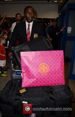 Andy Cole - Manchester United Players arrive at Manchester Airport while a boax hoax drama was unfolding. - Manchester, United...