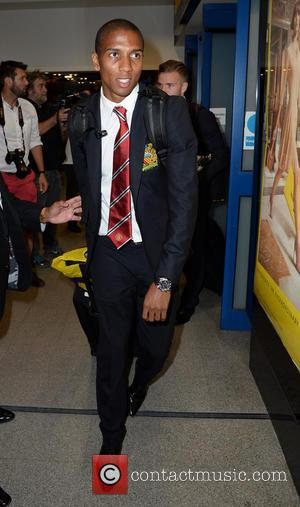 Ashley Young - Manchester United Players arrive at Manchester Airport while a boax hoax drama was unfolding. - Manchester, United...