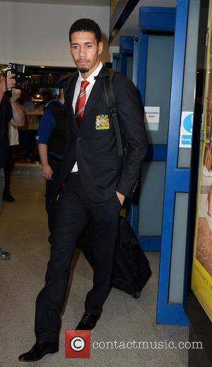 Chris Smalling - Manchester United Players arrive at Manchester Airport while a boax hoax drama was unfolding. - Manchester, United...
