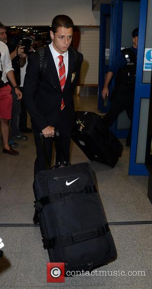 Javier 'Chicharito' Hernandez - Manchester United Players arrive at Manchester Airport while a boax hoax drama was unfolding. - Manchester,...
