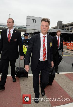 Louis van Gaal - Manchester United Players arrive at Manchester Airport while a boax hoax drama was unfolding. - Manchester,...
