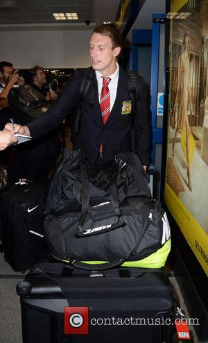Phil Jones - Manchester United Players arrive at Manchester Airport while a boax hoax drama was unfolding. - Manchester, United...