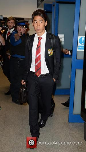 Shinji Kagawa - Manchester United Players arrive at Manchester Airport while a boax hoax drama was unfolding. - Manchester, United...