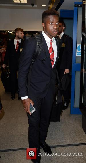 Wilfried zaha - Manchester United Players arrive at Manchester Airport while a boax hoax drama was unfolding. - Manchester, United...
