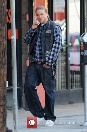 Charlie Hunnam - Charlie Hunnam is all smiles while filming for the hit show 'Sons of Anarchy' in Downtown Los...