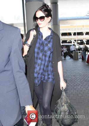 Eva Green - Eva Green, wearing a plaid top and sunglasses, at Los Angeles International Airport (LAX) - Los Angeles,...