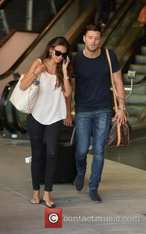Michelle Keegan and Mark Wright - Michelle Keegan and Mark Wright arrive at Manchester Piccadilly Train Station. - Manchester, United...