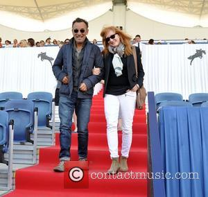 Bruce Springsteen and Patti Scialfa - Singer Bruce Springsteen and wife Patti Scialfa cheer on thier daughter Jessice Rae Springsteen...