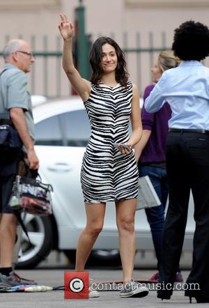 Emmy Rossum - Emmy Rossum filming on the set of 'Shameless' wearing a tight zebra print dress - Los Angeles,...